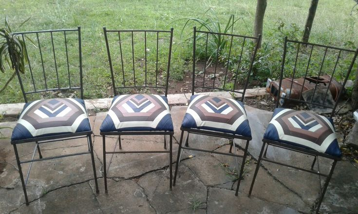 Metal chairs I found at the second hand shop. Re upholstered with foax leather quilt pattern.