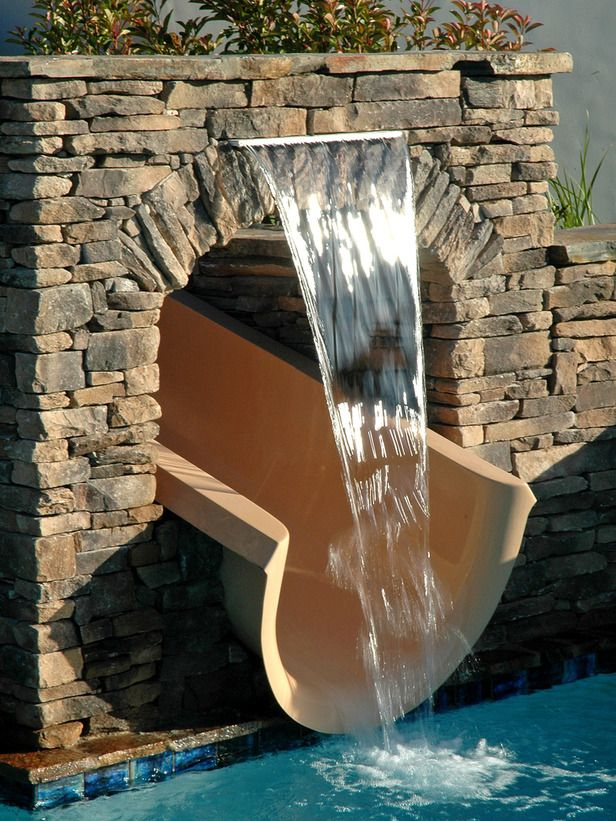 gotta have A waterfall cascading from a faux stone arch at the base of a custom waterslide creating a surprise ending for the kiddos :) AND adults hehe ;)... we like to have fun too