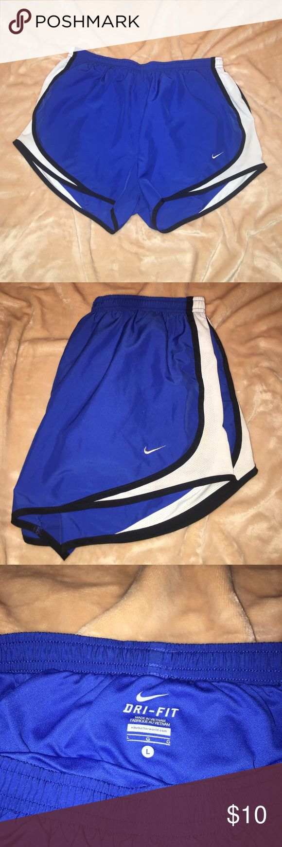 Royal blue Nike Dri-Fit athletic shorts Royal Blue/White Nike Dri-Fit Athletic Shorts. Size large. Missing drawstring but otherwise in great condition. Nike Shorts