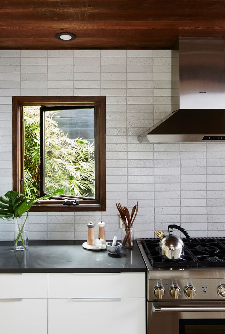 earthy modern kitchen with tile backsplash 25