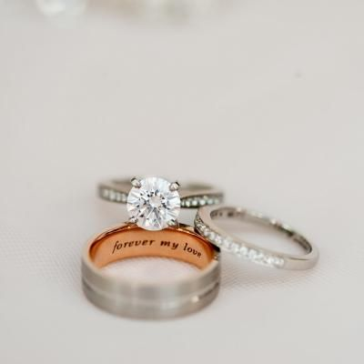 brides diamond wedding band and engagement ring with round cut single diamond along with grooms