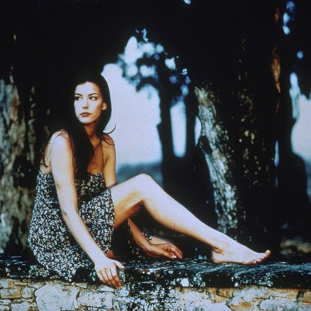 """A young Liv Tyler in Bernardo Bertolucci's """"Stealing Beauty"""" (1996) dressed by Giorgio Armani."""