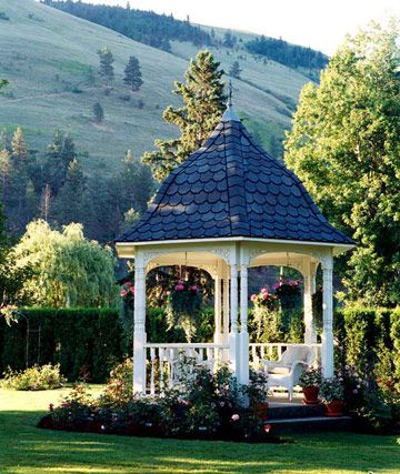 Focal-Point Gazebo -- Set in a distant corner of the backyard w/ scalloped roof shingles on a charming bell-shape roof