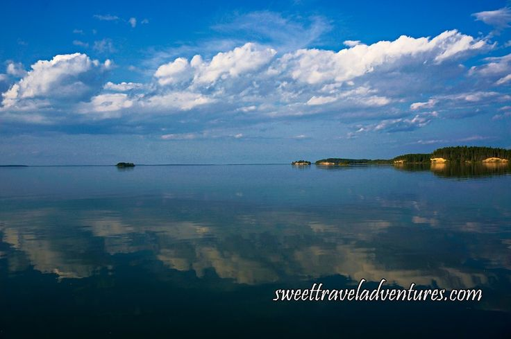 Sky and Islands Reflected on Crean Lake in Prince Albert National Park, Saskatchewan, Canada