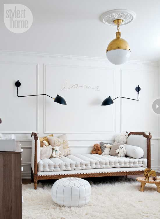 Beautiful white based decor in this little boy's bedroom... love the white leather pouffe!