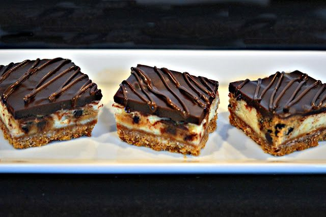 COOKIE DOUGH CHEESECAKE BARS TOPPED WITH A CHOCOLATE GLAZE!