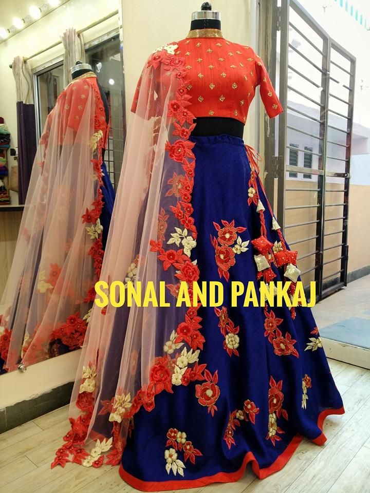 Beautiful royal blue color lehenga and red color boat neck blouse with net dupatta. Lehenga and dupatta with floral design hand embroidery work. Whatsapp for ur bookings at +919669166763 30 January 2018
