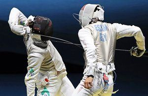 Henrique Marques of Brazil in action against Mohamed Essam of Egypt during the men's foil individual round.