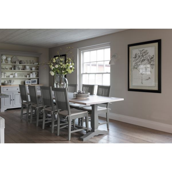 Harrogate Rectangular Table With Six Harrogate Dining Chairs The beautifully designed Harrogate table has a solid oak table top and unusual pedestal ends that are hand-painted in Fog. The table works well with the Harrogate dining chairs. There is a choice of fog or honed slate finishes and the chairs have natural linen seat pads which can be purchases separately here.