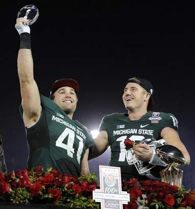 MSU's Kyler Elsworth and quarterback Connor Cook ceebrate the Rose Bowl Championship after MSU's 24-20 victory over Stanford in the Rose Bowl
