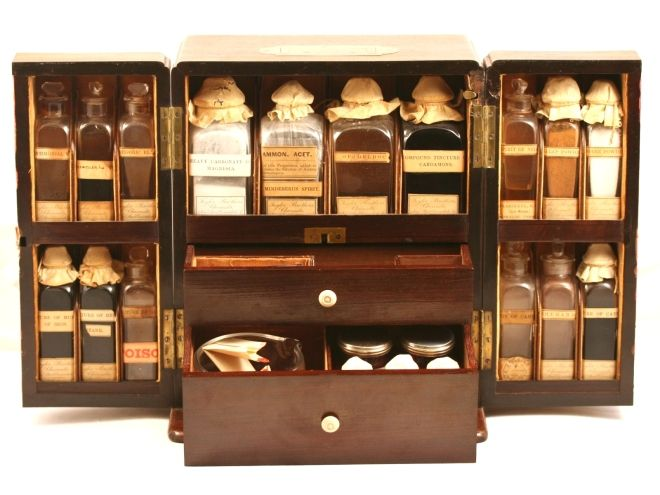 """'This chest was chosen as as the front cover illustration on Anne Young's definitive book """"Antique Medicine Chests"""". It is a superb example of a cupboard style mahogany chest  c.1860. A rod on the upper right of the front opens a hidden panel in the rear of the chest. Bottles labeled """"Taylor Bros Cavendish Square London"""".'"""
