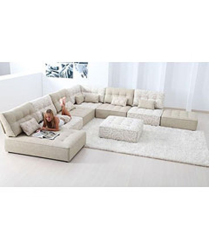 Bring a classic combination of leisure and modern #interiors in your #livingroom with Alice modular fabric #sofa set. It is an extra-large corner #sofaset and is fully furnished in beautiful creamy white finish.