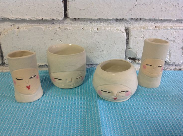 #pottery #ceramics # wheel work and handmade #happy faces #plant holders #sauce bowls #small holders