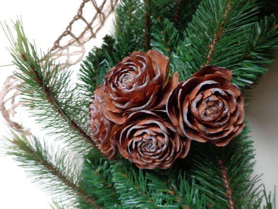 Grouping of deodar cedar pine cone roses christmas