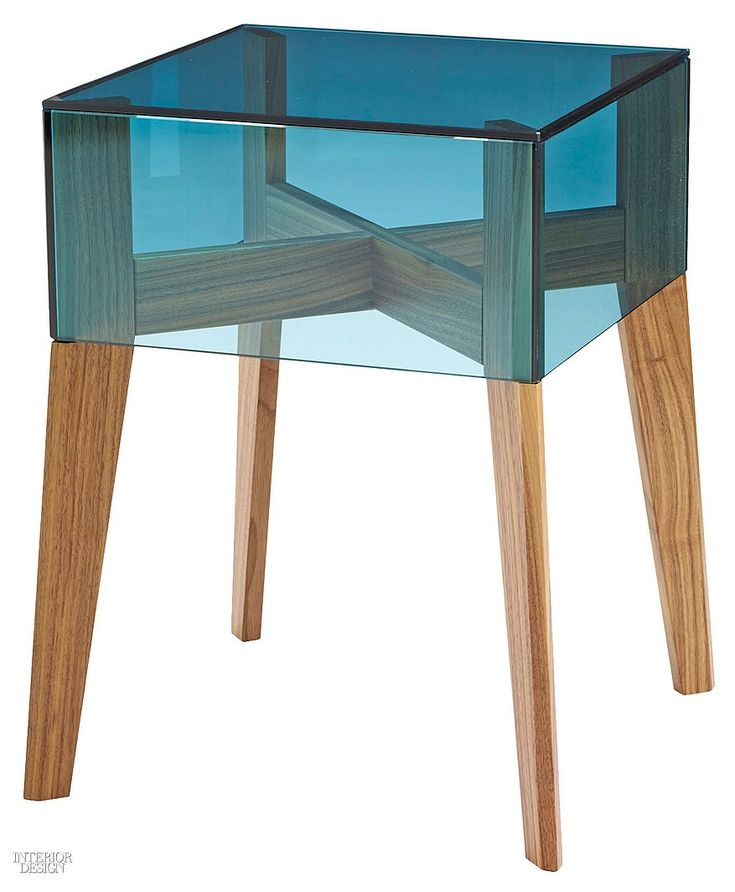 On the Rock table in tinted glass with walnut base by Ligne Roset.  Interior Design