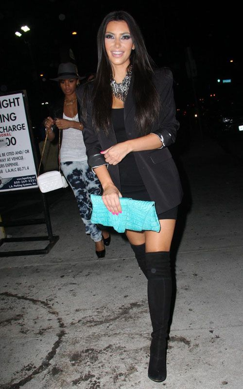Kim Kardashian wearing Juliette Jake Crocodile Wrap and Wrap Clutch in Turquoise Moschino Cheap & Chic Over-the-Knee Wedge Boots Bebe Sleek Double Stitched Blazer Monrow    Doubleknit Racer Back Dress  Clubbing in LA August 3 2009                                holy shit her old face :( she looked pretty