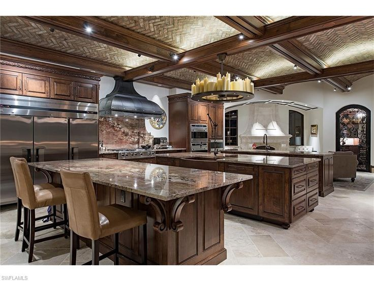 Open Layout Luxury Craftsman Kitchen With Three Islands