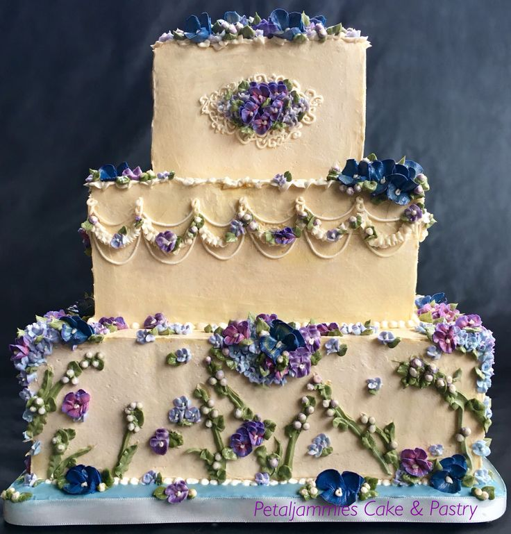 Gorgeous 3 tier square wedding cake with buttercream flowers (buttercream pansies, buttercream violets, buttercream hydrangeas) in ivory, purple, and blue for Pittsburgh weddings by Petaljammies Cake & Pastry  Beautiful cake!