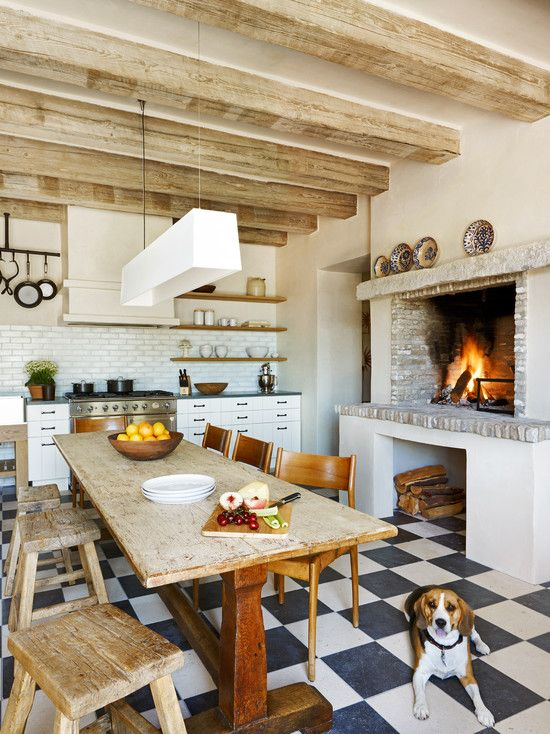 Gorgeous bright kitchen with a rustic feel.. the brick oven fireplace is love <3....and, i'm quite certain i'd be roasting mallows in there :)