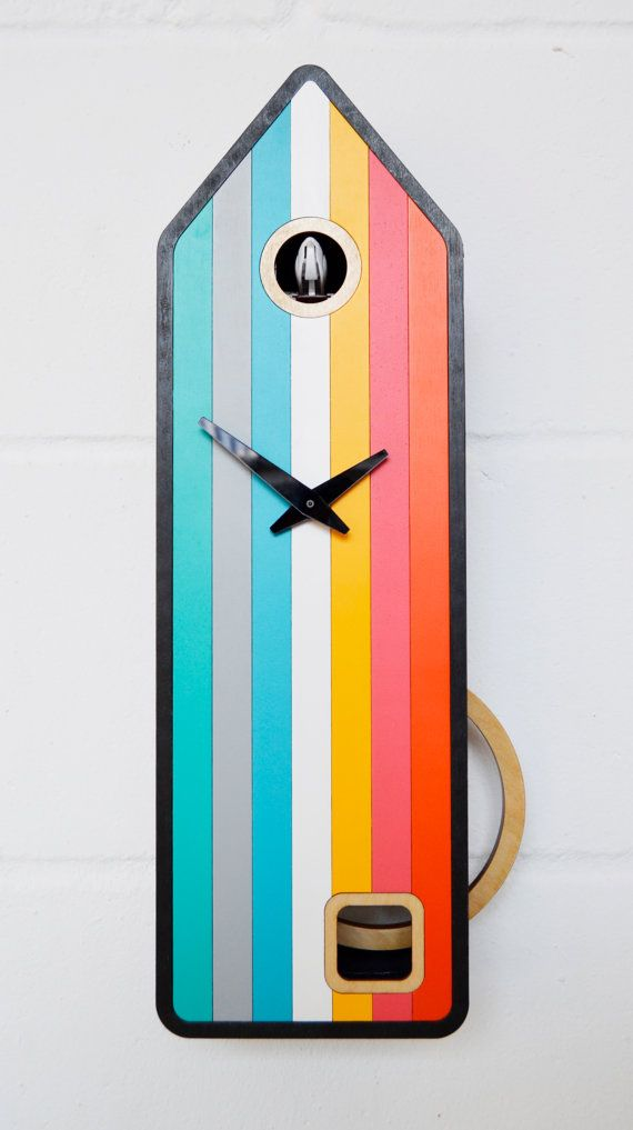 Color-House is a modern cuckoo clock inspired by the original Black Forest cuckoo clocks. It has a black frame complemented by 7 different colors on its face: turquoise, grey, blue, white, yellow, pink and orange. The large pendulum which is as wide as the clock itself swings elegantly through the two side windows which have a natural birch finish.  The mechanism is battery operated and is equipped with a light sensor so when the sun goes down or the lights are off the bird does not come…