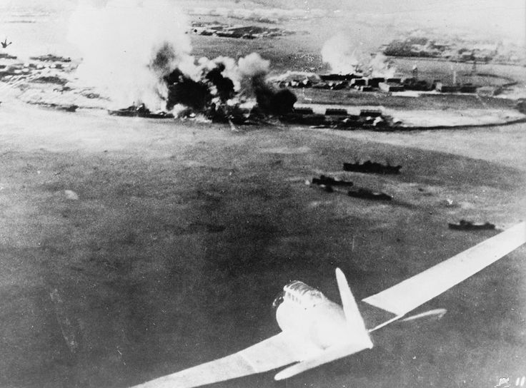Aerial photograph, taken by a Japanese pilot, of the attack on Pearl Harbor, a Japanese bomber in lower-right foreground. (Library of Congress)