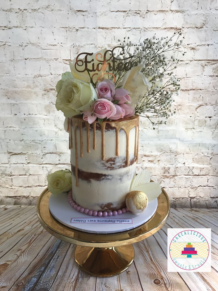 Gold and floral naked drip cake
