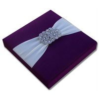 Handmade silk invitation box with rhinestone brooch on a luxurious satin ribbon. Our invitation boxes are perfect to reflect your wedding theme or style.