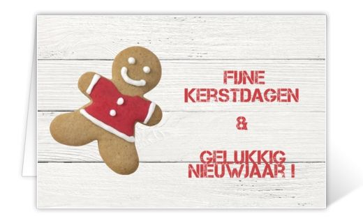 Christmas card with wooden background, gingerbread man and red text