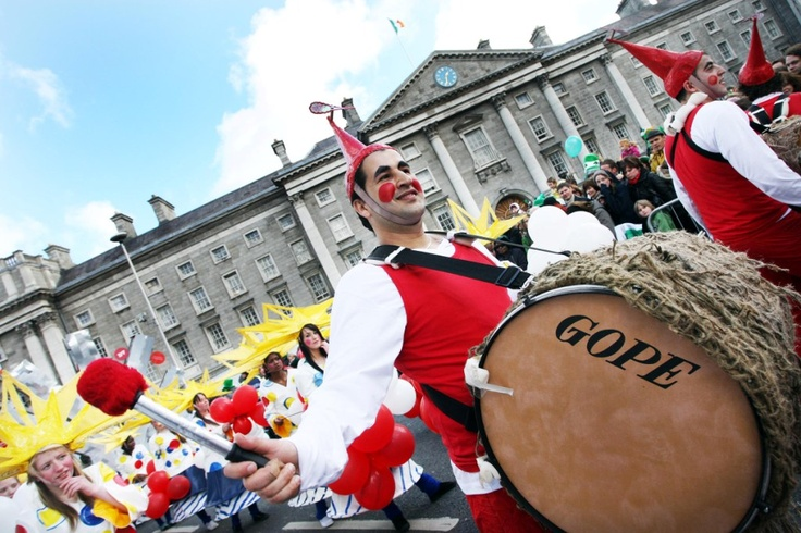A drummer enjoying the atmosphere as part of the parade as it passes by Trinity College