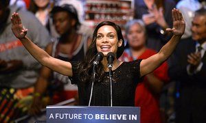 Rosario Dawson introduces US Democratic Presidential candidate Bernie Sanders during an election campaign rally at the Wiltern Theatre in Los Angeles.
