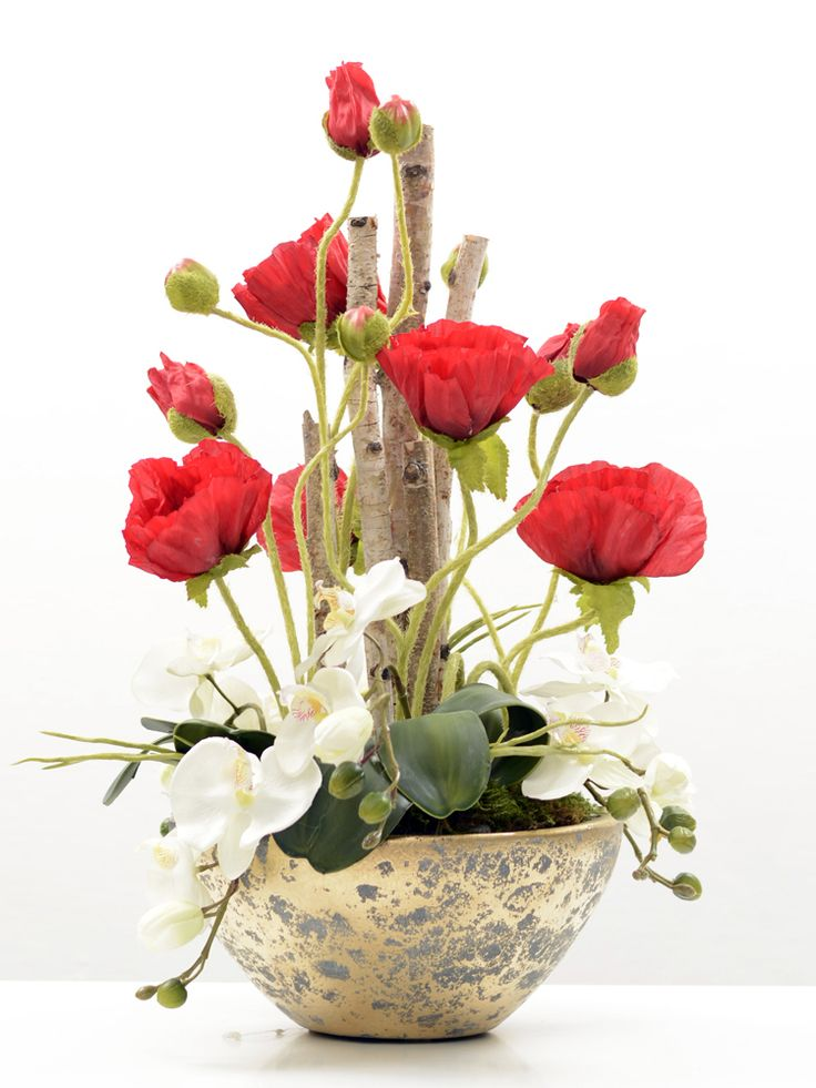 Red Poppies and white mini phalaenopsis orchids.