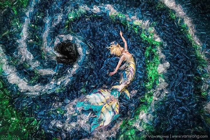 Mermaids Swim In A 10,000 Plastic Bottle Ocean To Show How Much Average Person Pollutes Earth