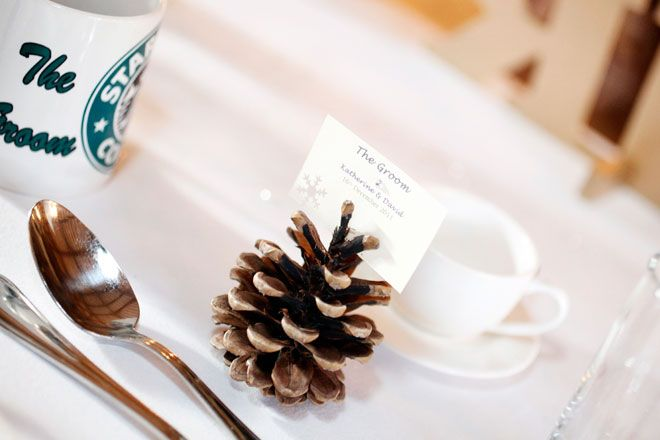 Pinecone place cards at a Rivervale Barn Christmas wedding | www.allabouttheimage.co.uk