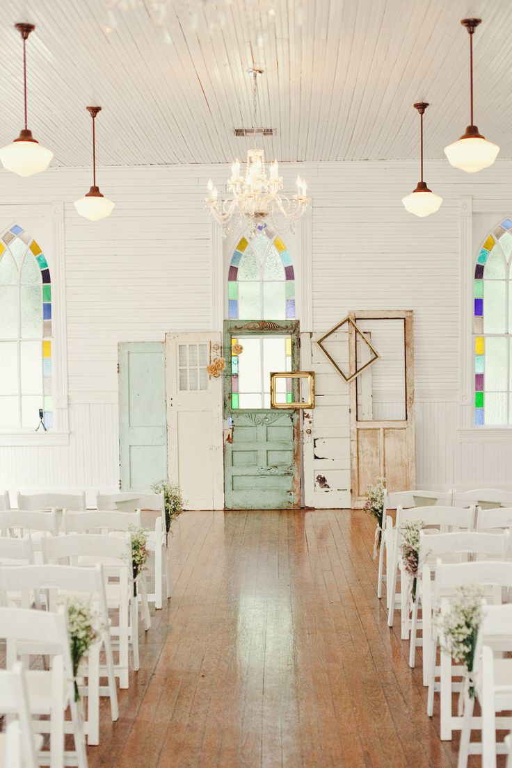 Altar area made of old doors. Rent similar white & aqua doors from…