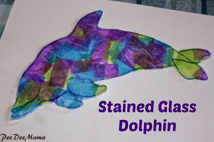 Stained glass dolphin made with wax paper, colored tissue paper, glue, and a sharpie.