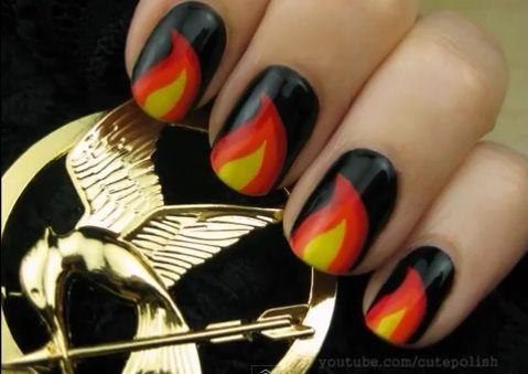 Hunger Games #Nails! May the odds be ever in your favor! #hungergames   http://hellogiggles.com/the-hunger-games-nail-art-playlist