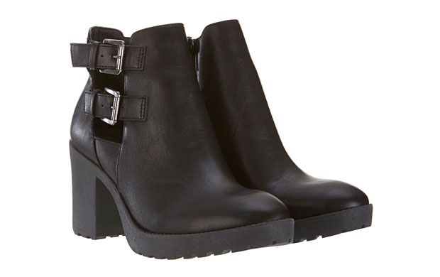 "Black Ankle Boots. ""The chunky heel and silver buckle detailing offer a hint to the nineties in these black ankle boots."""