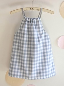 Lovely little dress for warm sunny days!   Made out of a grey white checked cotton, the dress is hold by strings and a bow in the back. For a better fit the back is elasticated. The fluorescent yellow thread on all seams accentuates on the grey fabric.