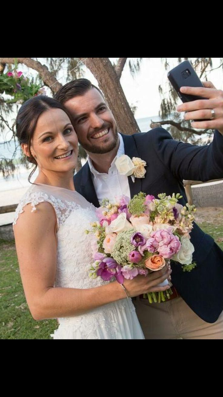 Elopement couple in Noosa. Soft pastel selection of Peonies, tulips, David Austin roses, roses and Queen Annes Lace