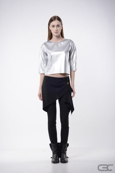 http://cbcdesign.ro/en/shop/pants-cold-planet-2/  Long pants with golden zipper on the left side and crepe fabric triangles inrested on each side. With the help of a golden clip suspender, the triangles form a faux skirt, giving a more feminine allure.