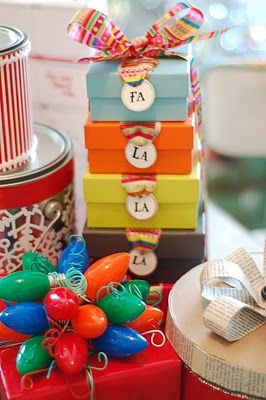 Two easy ideas:  Little boxes with Fa la la la labels, and what to do with all of those burned out Christmas lights?  Turn them into a bow!  very clever! for @Amy HudginsParty Favors, Holiday Ideas, Christmas Parties Favors, Gift Wrapping, Wraps Ideas With Bows, Christmas Bows, Christmas Lights, Gift Wraps, Gift Tags