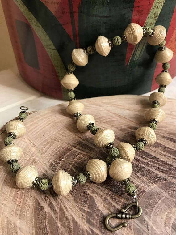 Elegant necklace made with beige recycled paper beads and moss