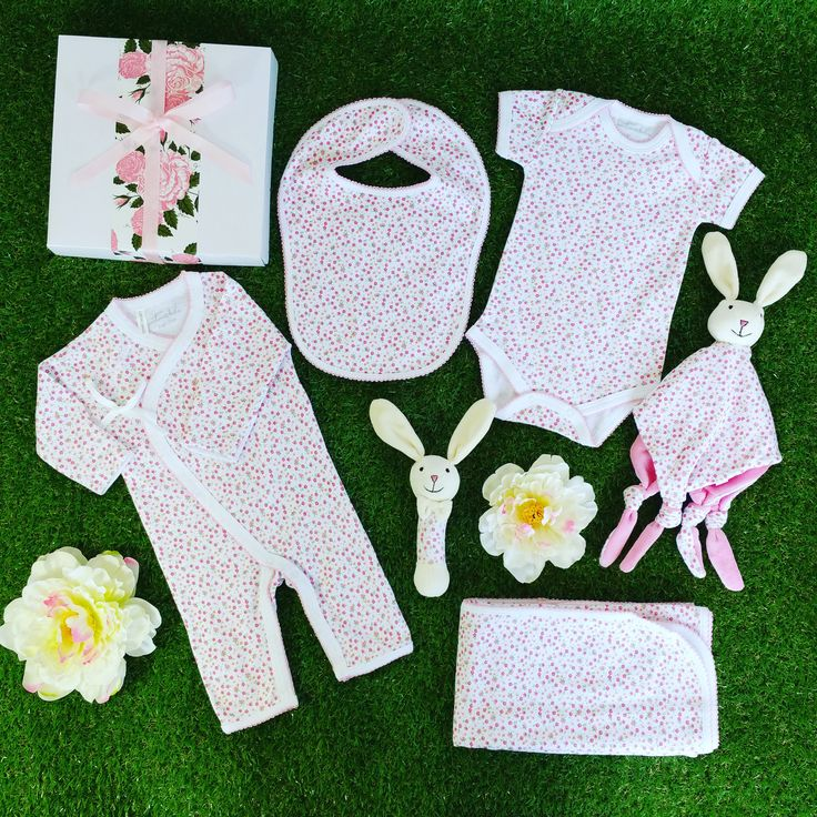 Spring Blossom baby girl gift hamper. Gorgeous blossom design baby clothing along with a matching bunny rattle and comforter. #babygirlgift #babygift