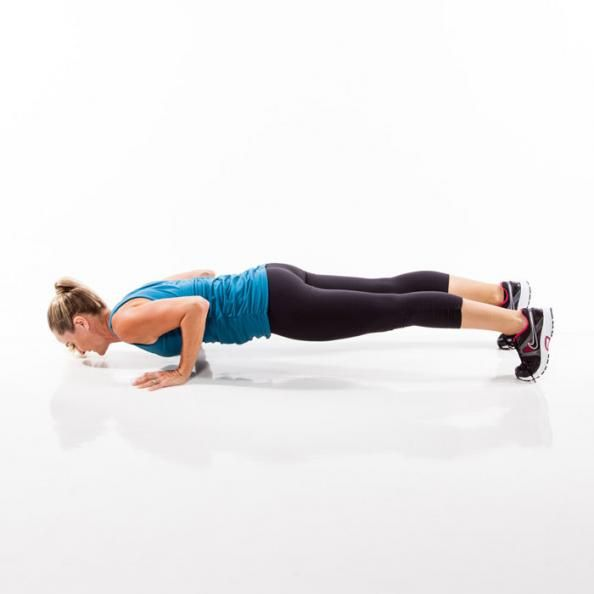 Push hips back and bend knees to lower into a squat. Place hands on the floor and quickly walk feet back into a full plank position. Immediately lower into a pushup. Press up, walk feet back into squat, and return to standing, reaching arms overhead. Thats one rep. Repeat as quickly as possible for 45 seconds.