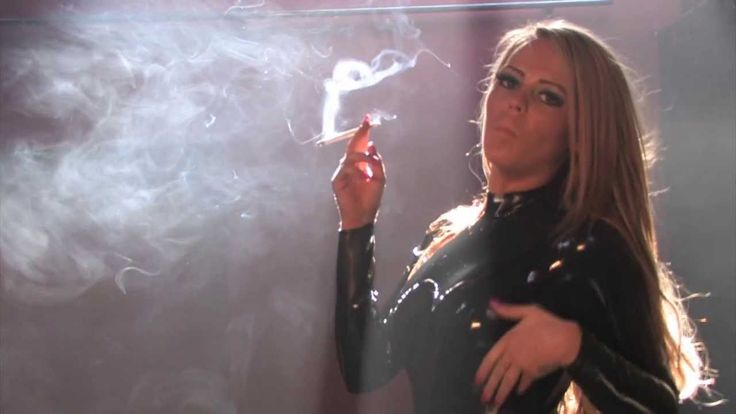 Katie smoking all white 120s in latex catsuit