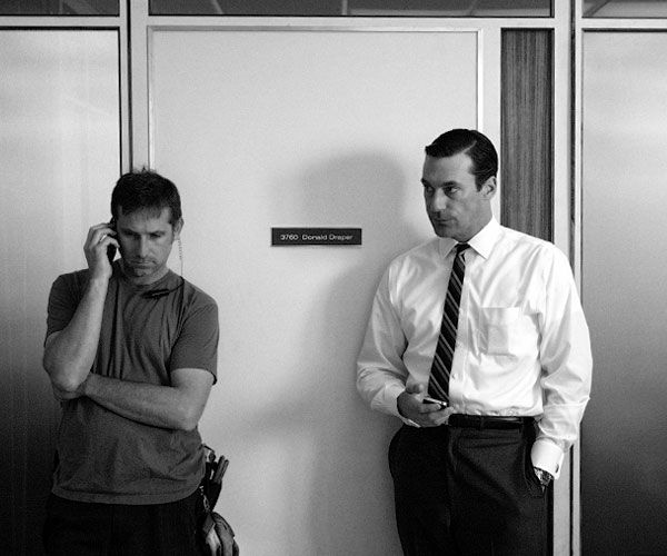 don draper checking his iphone- photo by James Minchin III for Rolling Stone