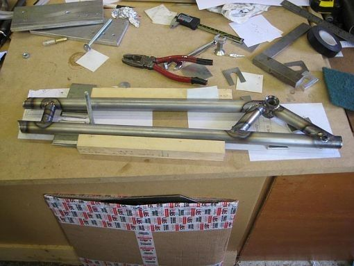 Swingarm Jig by abarthx19 -- Homemade swingarm jig constructed from MDF, plywood, and extruded aluminum. http://www.homemadetools.net/homemade-swingarm-jig
