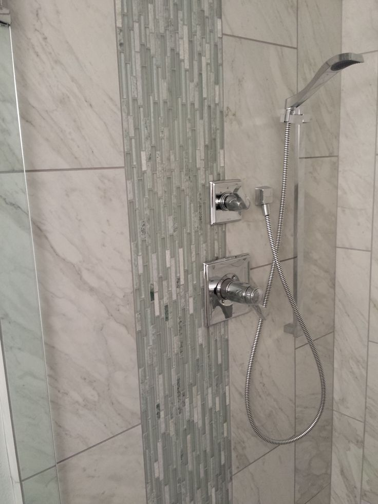 Hall Bath with porcelain marble tile and vertical glass deco band.