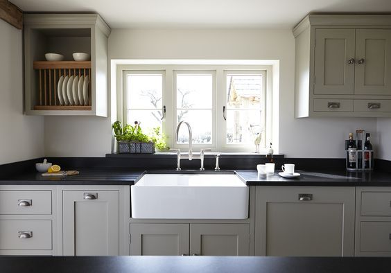 Love this style, - and maybe this is the colour to go for. Interesting how the wall units have been used togo right to the top of the walls to meet the low ceiling. Farrow and Ball Hardwick White on painted Modern Country Kitchen