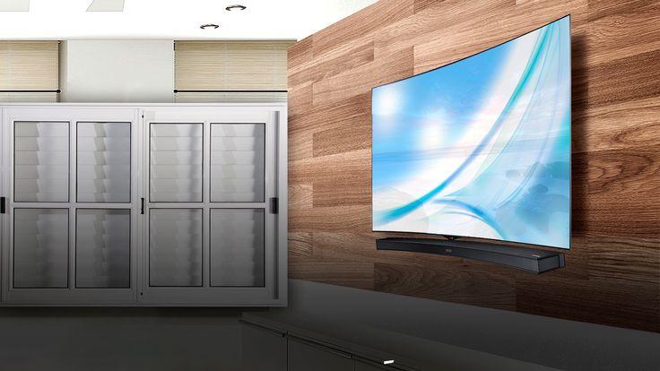 instalacion de TV curvo con barra de sonido